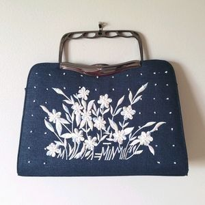 Blue bag with white floral beaded embellishments